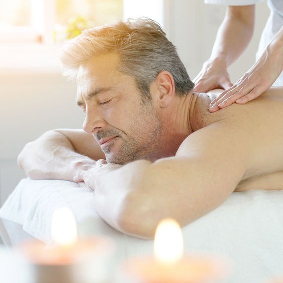 Man relaxing on massage table receiving massage